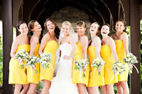 strapless yellow over the knee bridesmaid dresses are great for spring or summer weddings