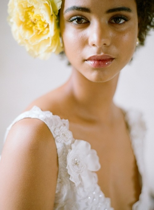 an oversized bold yellow bloom to accent a bridal hairstyle is a lovely idea for a spring wedding