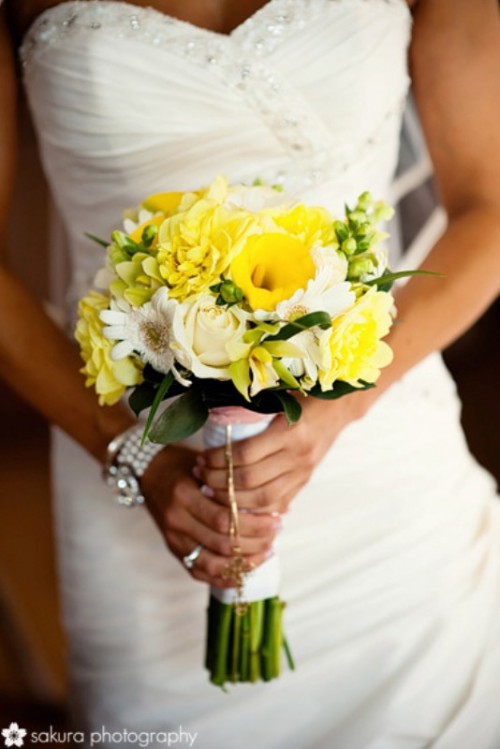 a bright yellow and white wedding bouquet with some greenery is a lovely idea to add color to the look