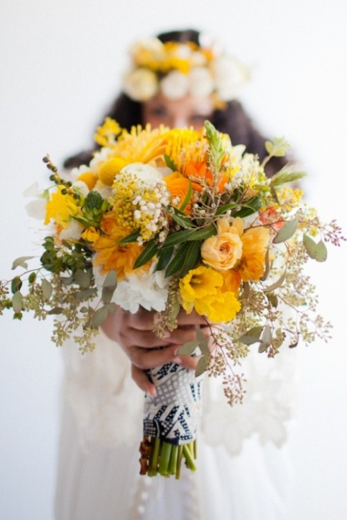 a bold yellow wedding bouquet with white blooms, greenery, billy balls and eucalyptus is a cool option for spring