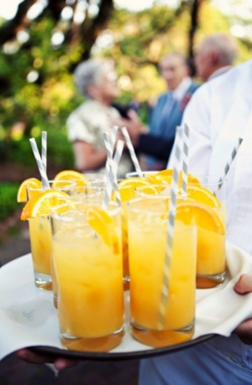 bold yellow lemonade with citrus slices are a great idea of a refreshing drink at a spring wedding