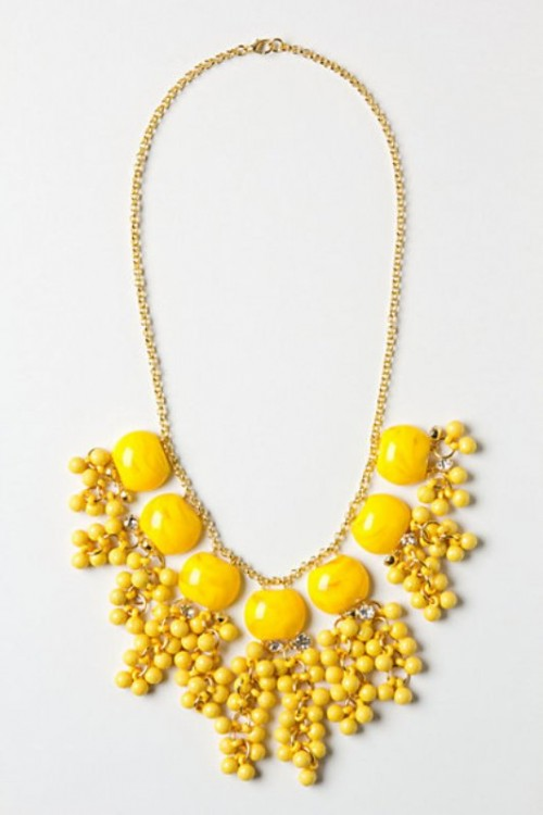 a statement gold necklace with yellow beads and stones is a gorgeous idea for a spring or summer bride