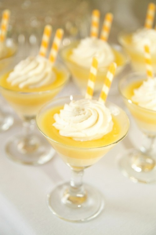 a lemon wedding dessert and drink with some cream on top is a lovely idea for a bold yellow spring wedding