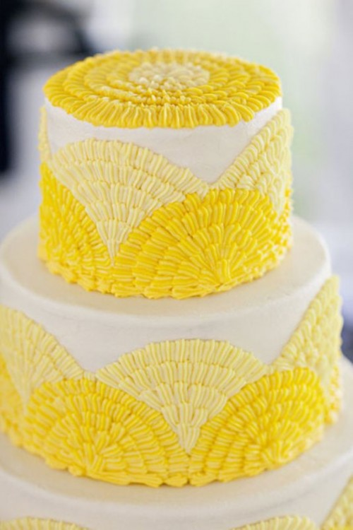 a bold wedding cake with light and bright yellow textural patterns is a cool solution to rock
