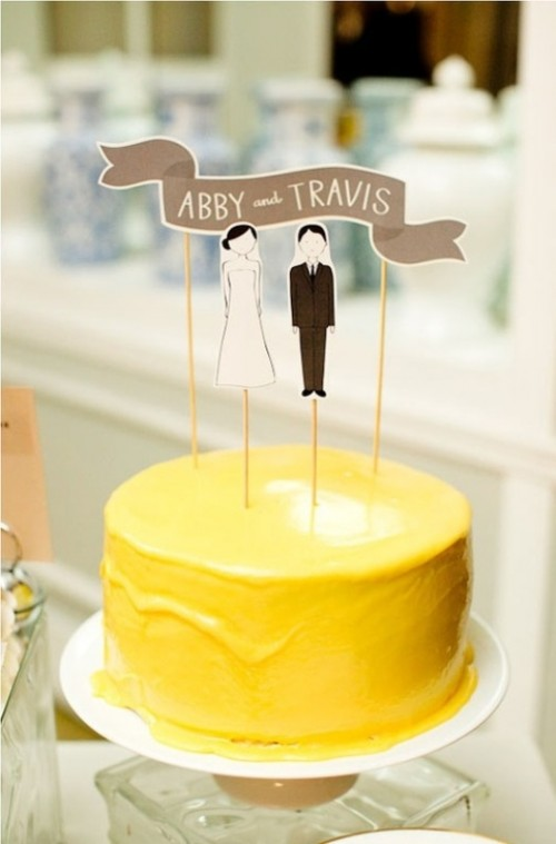 a bold one tier yellow wedding cake with simple toppers is a lovely idea with much color