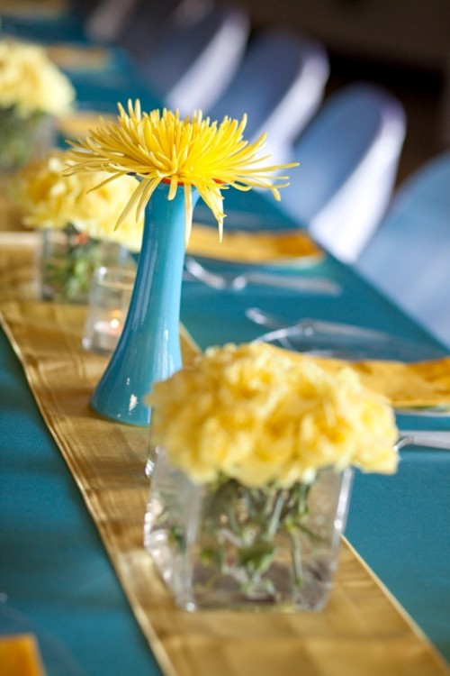 bold yellow blooms in vases and yellow linens will accent your spring wedding tablescape