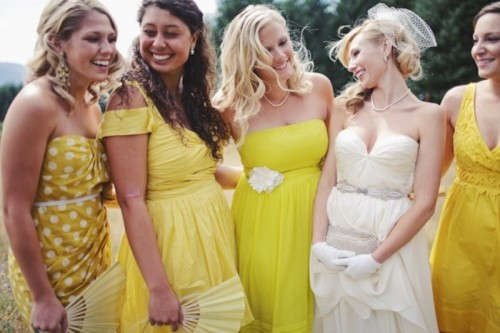 bold yellow mismatching bridesmaid dresses of various kinds are great for a fun and bold spring wedding