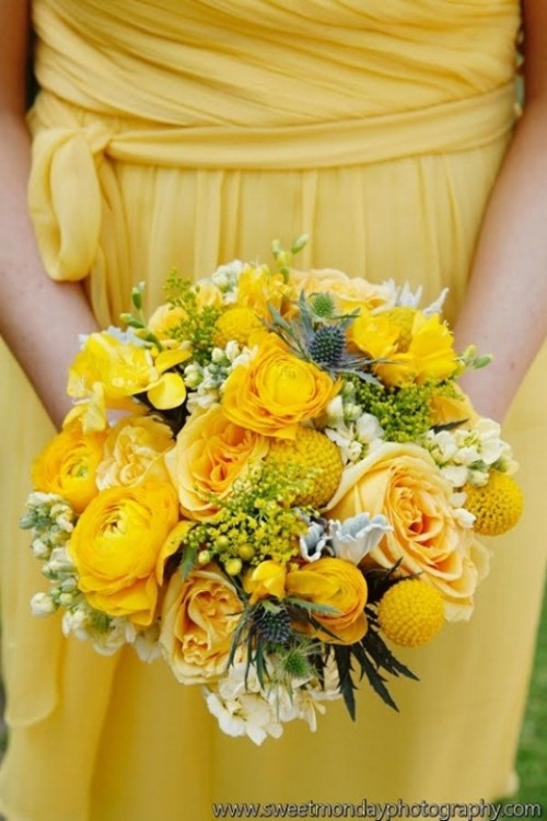 a yellow draped bridesmaid dress with a sash and a matching bouquet with thistles and greenery