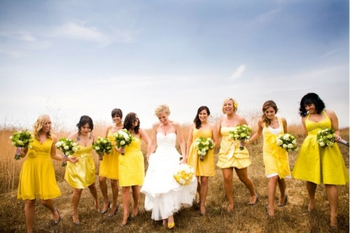mismatching yellow knee bridesmaid dresses are great for a spring or summer wedding