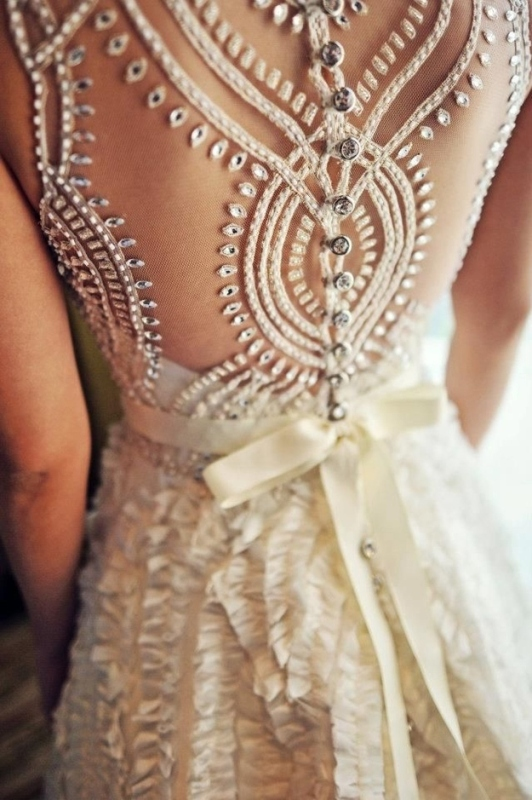 a beautiful illusion embellished back on rhinestone buttons and with a tiny ribbon bow to accent the waist