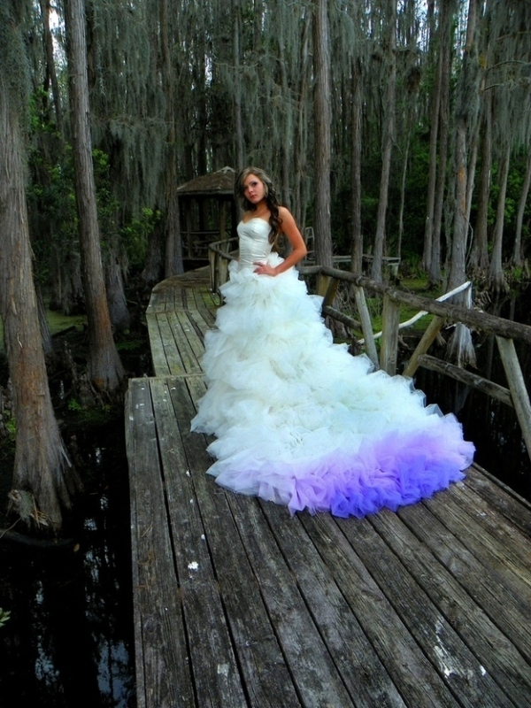 an ombre white to bright purple wedding dress train will make a statement with its bold color
