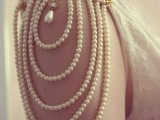 a gorgeous embellished sleeves of strands of pearls and with a tear drop pearl for an accent