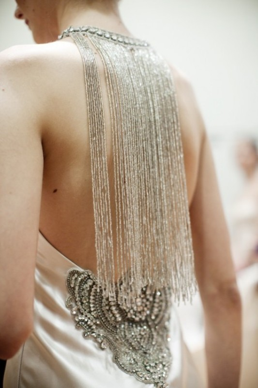 a stunning necklace with long shiny silver fringe that accents the open back and makes a fashion statement