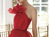 a hot red wedding dress with a layered bodice that forms a giant flower is a bold statement to rock