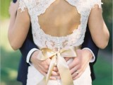 a lace keyhole back with a tan silk ribbon bow on the waist is a cool and refined option to try