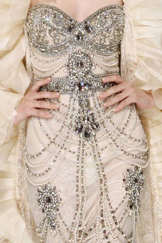 a refined strapless fully embellished wedding dress with an embellished sash and pearls all over just wows