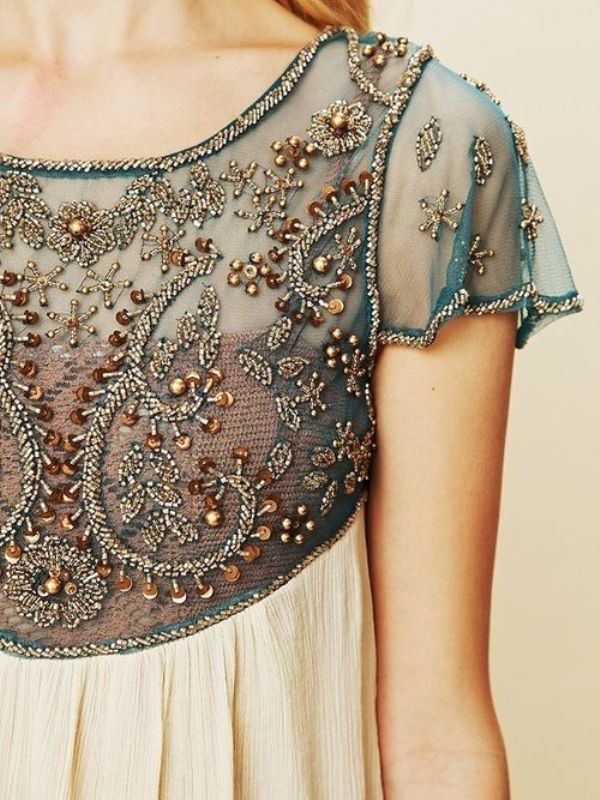 a sheer teal wedding dress bodice with heavy embellishments and embroidery in gold, teal and copper will make you stand out for sure