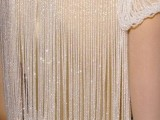 a wedding dress back with rhinestone straps and matching sleeves is a bold and cool idea to shine all over