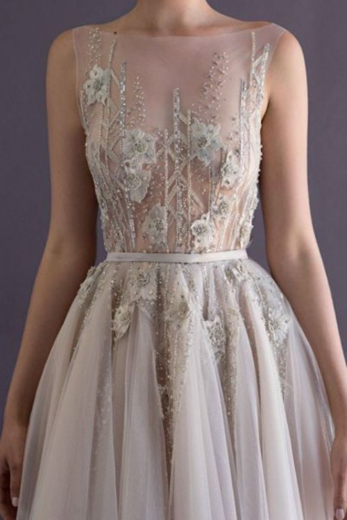 a beautifully embellished and embroidered wedding dress with floral appliques placed strategically