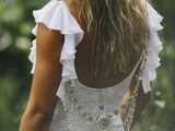 heavy embellishments hanging under the cutout back highlight it and make the look more boho and catchy