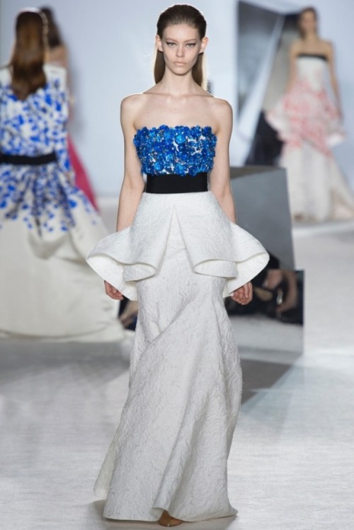 a contrasting bold blue floral bodice and a sculptural neutral skirt create a very bold and non-traditional look