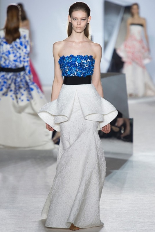 a contrasting bold blue floral bodice and a sculptural neutral skirt create a very bold and non traditional look