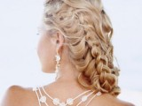 a wavy half updo with several braids is a great idea for long hair, with much dimension and eye-catchiness