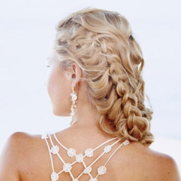 a wavy half updo with several braids is a great idea for long hair, with much dimension and eye catchiness