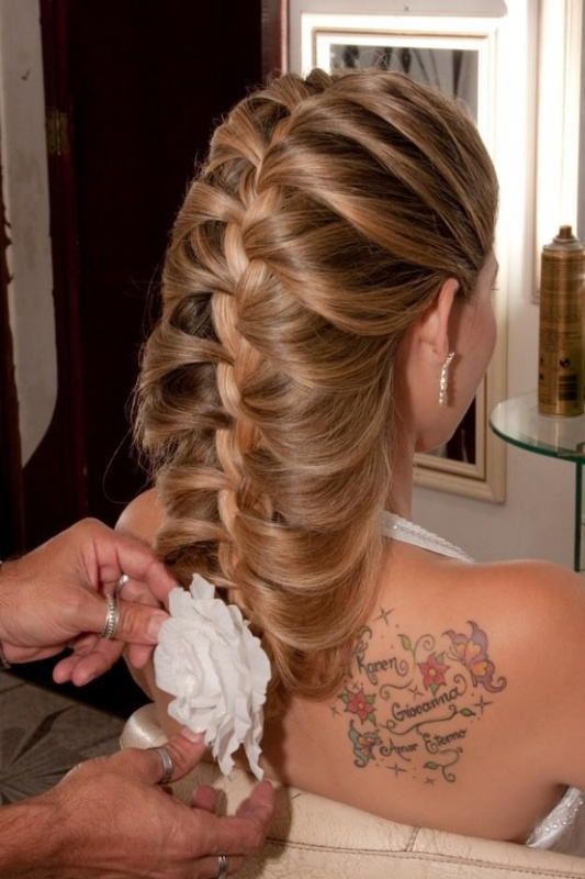 a large dimensional braid going down with a bloom in the end is a unique idea for long or medium length thick hair