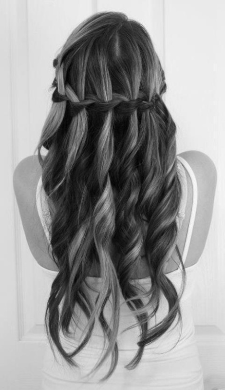 a beautiful wavy half updo with a horizontal braid is a gorgeous idea for medium length or long hair