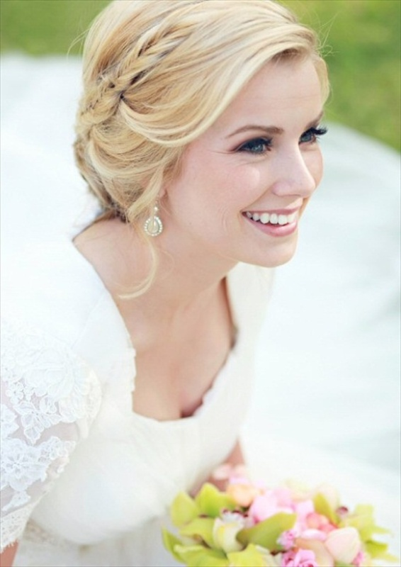 a relaxed updo with a single braid and some locks down is a chic idea
