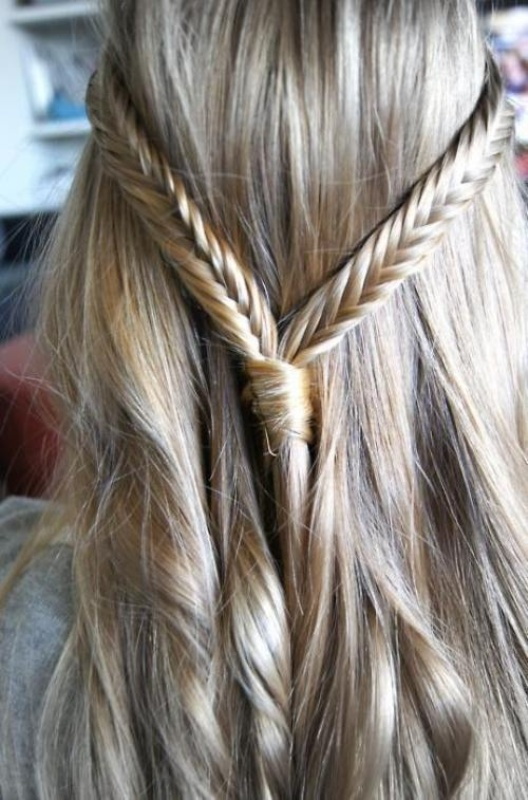 a textural half updo with two fishtail braids on top is a cool boho chic option