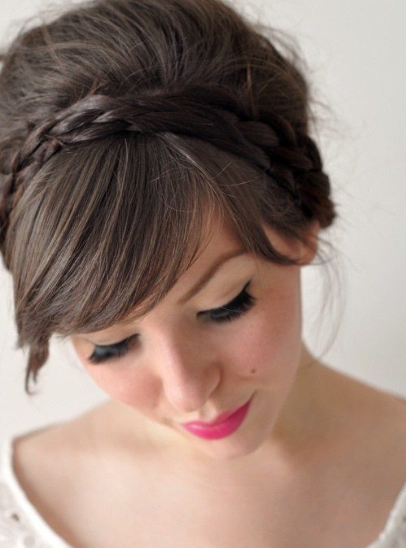 an updo with a dimensional bump, two small braids and bangs is a chic idea with a retro feel