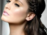 a half updo with wavy hair and a braided halo is a cool idea for a bride or bridesmaid