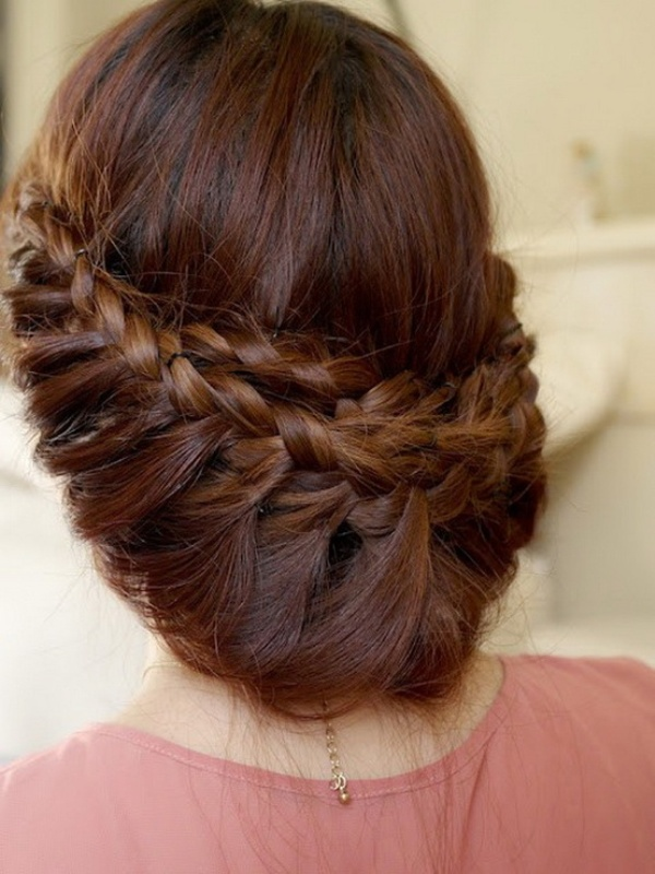 a low updo with several braids and much dimension is a proper idea for long hair