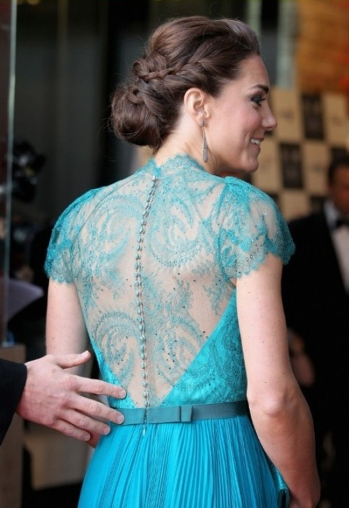 a low bun with a bump and a braid integrated is understated elegance with much chic