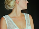 an updo with a braided halo and a large dimensional low bun plus a messy bump
