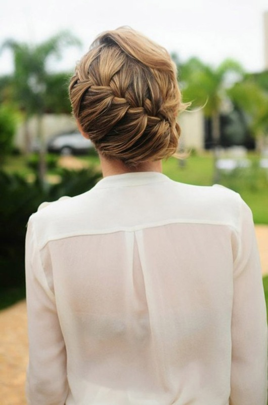 a low updo with a diagonal braid and locks down is an elegant and chic idea