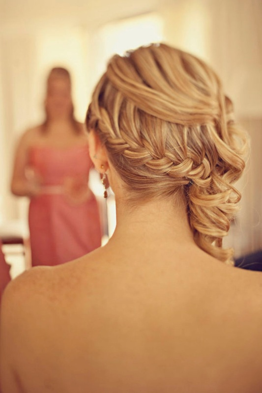 a half updo with a braided ponytail and waves on top is a unique and versatile hairstyle