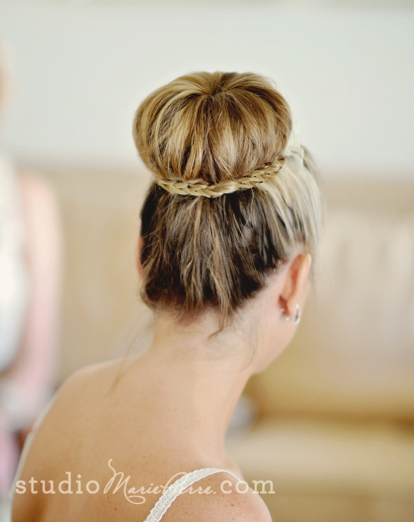 an elegant top knot with a braid that surrounds and highlights it looks super chic and elegant