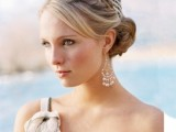 a low bun with bangs to frame the face and a braid on top is a very elegant hairstyle