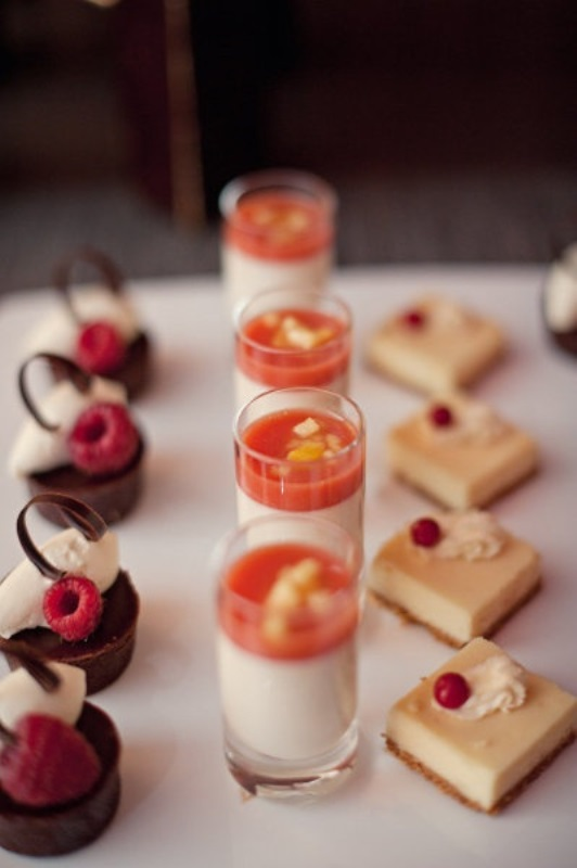 mini desserts chocolate and vanilla desserts with berries on top and panna cotta in shots