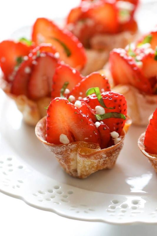 tasty cups with strawberries, herbs and touches of cream cheese
