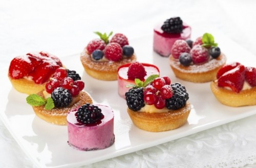 mini cups with cream and fresh berries, mini mousse cakes and jellies