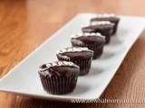 mini chocolate cupcakes with vanilla cream on top are a gorgeous decadent dessert