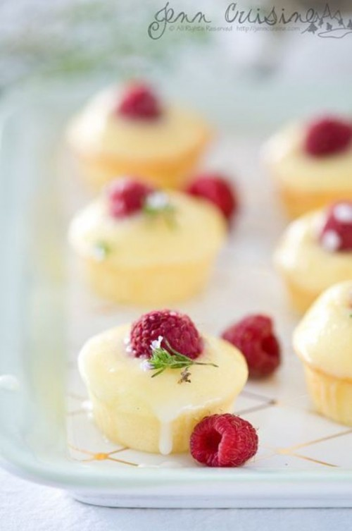 mini cheesecakes topped with glazing and raspberries will be a joy for everyone