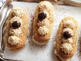 delicious eclairs with cream and cherries on top are a very refined dessert idea