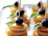 mini pancake kabobs with blueberries and honey on top is a tasty and hearty dessert idea