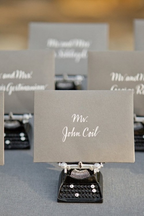 grey cards with white calligraphy are a cool idea for a modern wedding done in greys