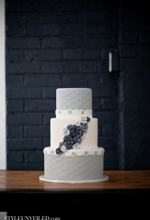 a grey and white wedding cake with textural tiers, navy sugar flowers looks unusual